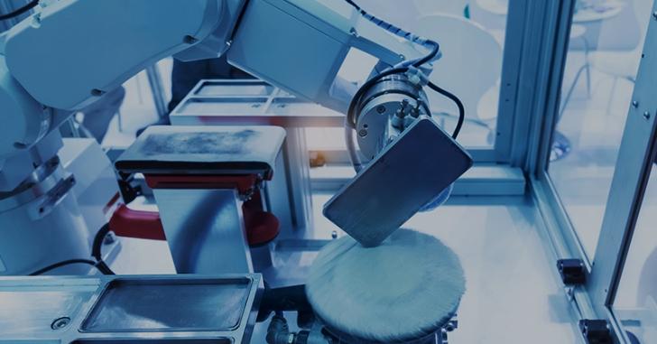 Foxconn заменяет сотрудников на роботов